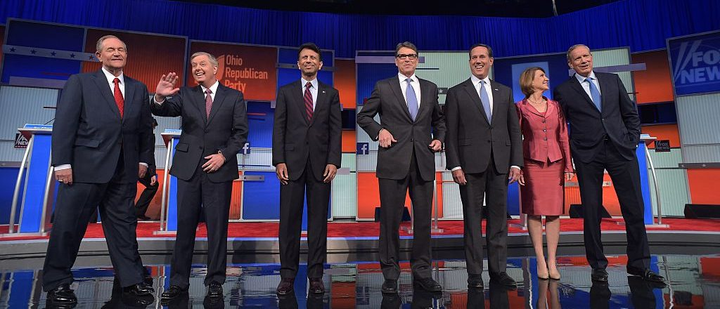 Republican presidential hopefuls (L-R) Jim Gilmore, Lindsey Graham, Bobby Jindal, Rick Perry, Rick Santorum, Carly Fiorina and George Pataki on stage for the start of the Republican undercard primary debate (Getty Images)