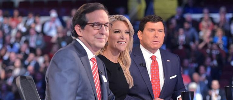 Prime time Republican presidential primary debate moderator Megyn Kelly (C) flanked by fellow moderators Chris Wallace (L) and Bret Baier (R) moments before the candidates arrived on stage at the Quicken Loans Arena in Cleveland, Ohio (Getty Images)