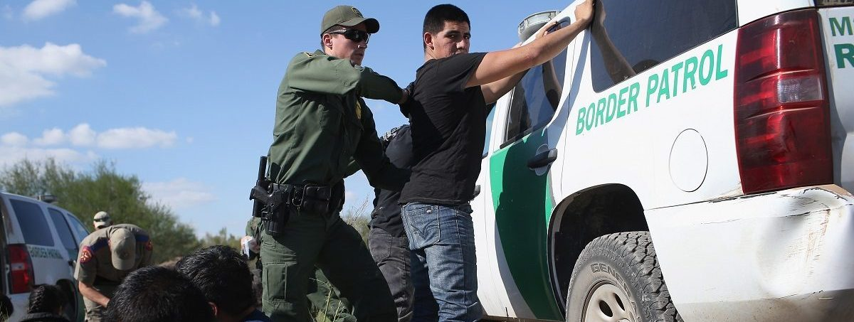 A U.S. Border Patrol officer body searches an undocumented immigrant after he illegally crossed the U.S.-Mexico border and was caught on December 7, 2015 near Rio Grande City, Texas. Border Patrol agents continue to detain hundreds of thousands of undocumented immigrants trying to avoid capture after crossing into the United States, even as migrant families and unaccompanied minors from Central America cross and turn themselves in to seek asylum. John Moore/Getty Images.