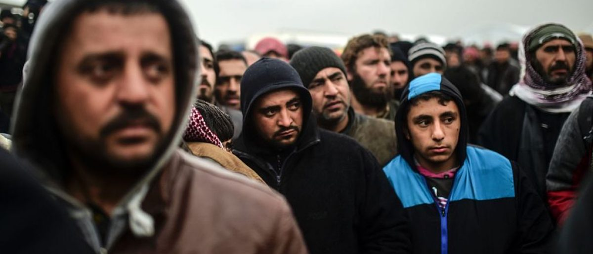 Syrian refugees at the Turkish border (Getty Images)