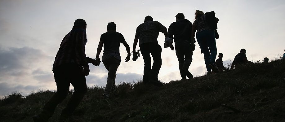 Undocumented immigrants are led after being caught and handcuffed by Border Patrol agents near the U.S.-Mexico border on April 13, 2016 in Weslaco, Texas