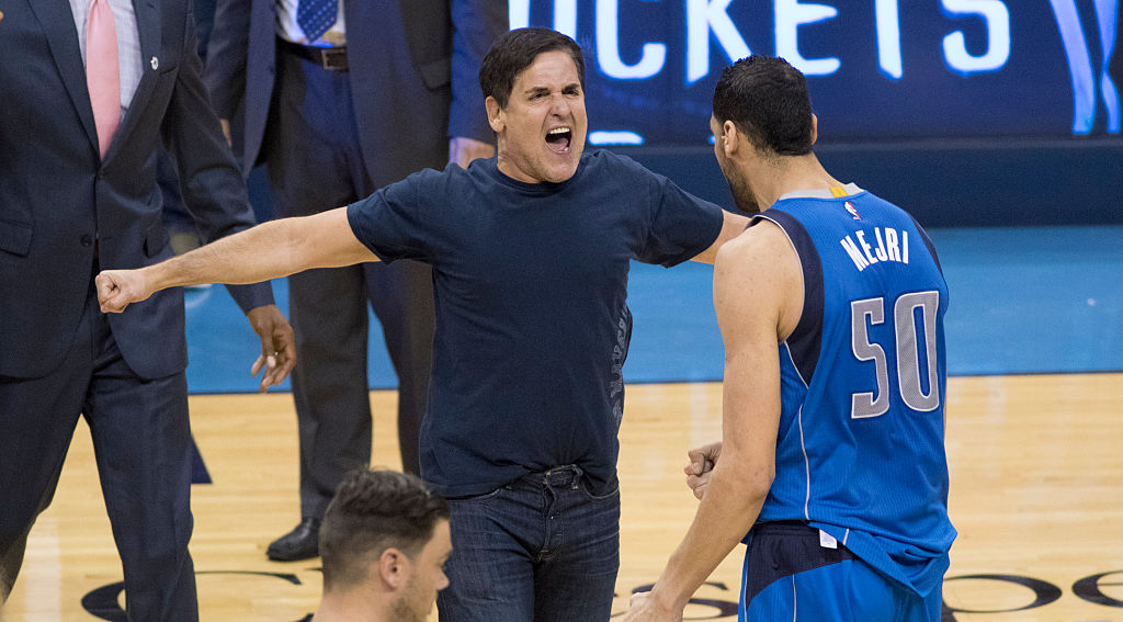 Mark Cuban owner of the Dallas Mavericks celebrates with Salah Mejri after Game Two of the Western Conference Quarterfinals (Getty Images)