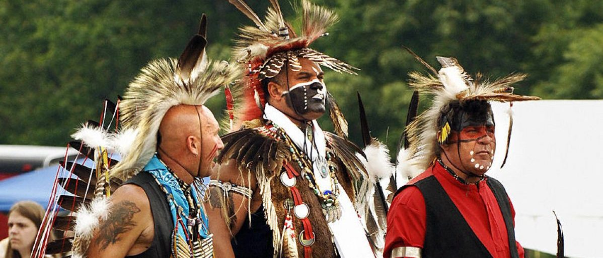 "O.T. Matthews (R) in regalia of the Lakota Native American tribe, Keith Anderson (C) of the Cherokee and Catawba tribes and a man who calls himself ""Thunderdancer"" of the Cherokee and Creek tribes during the Upper Mattaponi Indian Tribe Pow-Wow 28 May, 2005 in King William, Virginia. The annual event is a historical and cultural celebration of Native American heritage and gathers people and dancers from the region. Dancers at Pow-Wows across North America wear traditional regalia specific to their tribe or a mix from various tribes while drummers and singers chant traditional songs.  AFP PHOTO/Stan HONDA  (Photo credit should read STAN HONDA/AFP/Getty Images)"