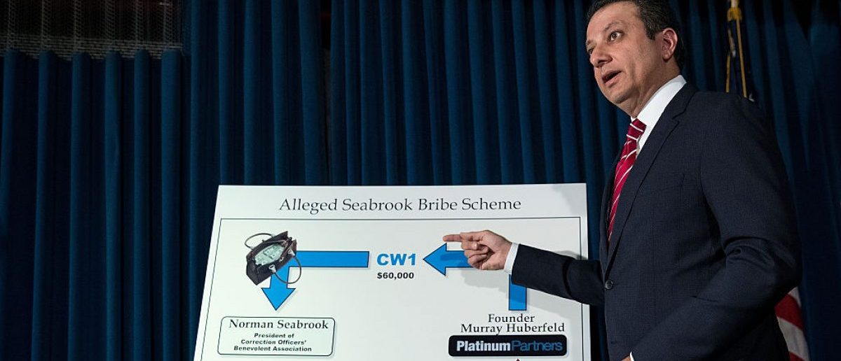 NEW YORK, NY - JUNE 8: Preet Bharara, U.S. Attorney for the Southern District of New York, gestures to a chart during a press conference to announce federal corruption charges against Norman Seabrook, president of the Correction Officers Benevolent Association, and Murray Huberfeld, founder of the New York-based hedge fund Platinum Partners LP, at the U.S. Attorney's Office for the Southern District of New York, June 8, 2016 in New York City. Seabrook is accused of taking bribes from the New York-based hedge fund Platinum Partners LP. (Photo by Drew Angerer/Getty Images)
