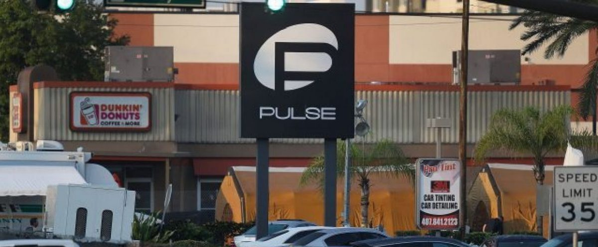 Law enforcement officials investigate near the Pulse nightclub. (Photo: Getty Images)
