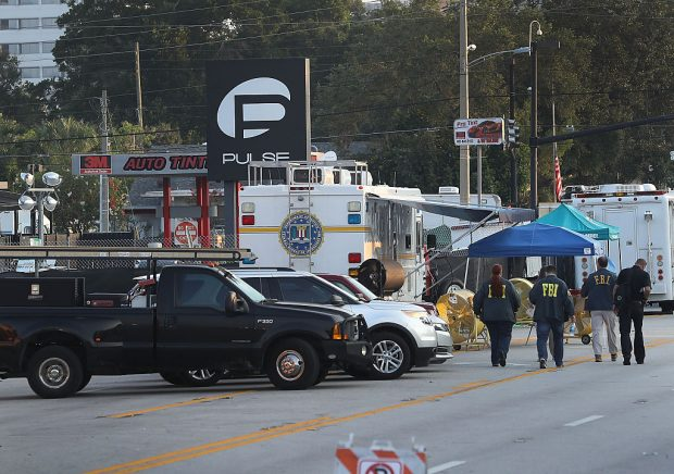 ORLANDO, FL - JUNE 15: Law enforcement officials continue to investigate the Pulse gay nightclub where Omar Mateen killed 49 people on June 15, 2016 in Orlando, Florida. The mass shooting killed 49 people and injuring 53 others in what is the deadliest mass shooting in the country's history. (Photo by Joe Raedle/Getty Images)