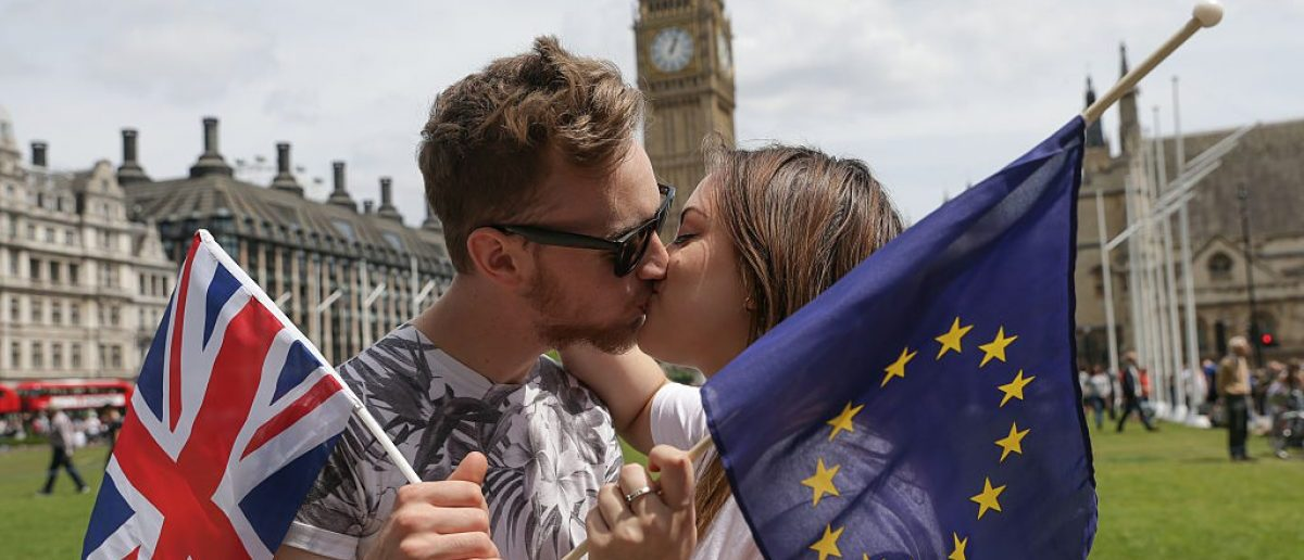 Brits and Europeans gathered at Parliament to kiss each other to show the love between Britain and Europe ahead of the EU referendum in an event urging a 'remain' vote in the EU referendum. / AFP / Daniel Leal-Olivas (Photo credit: DANIEL LEAL-OLIVAS/AFP/Getty Images)