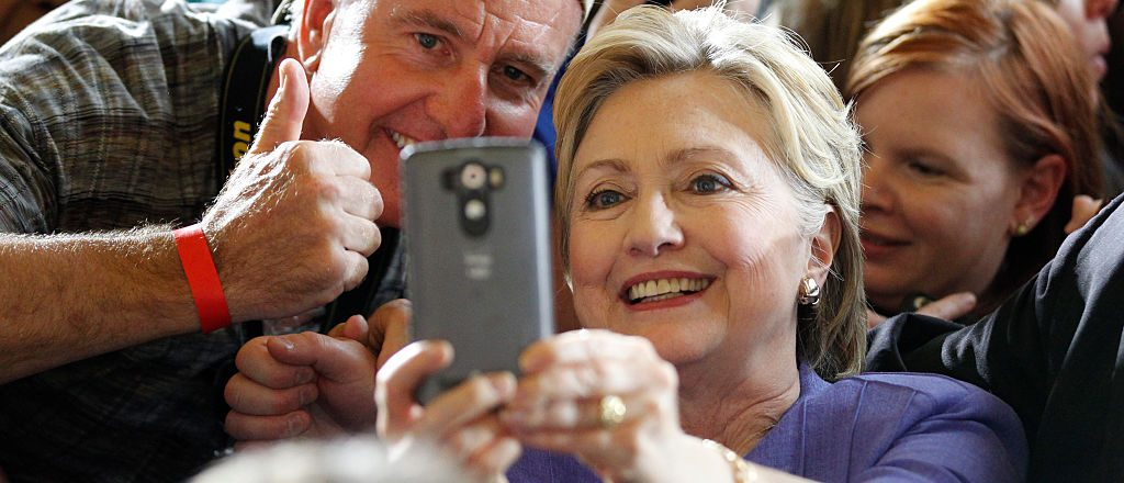 Hillary Clinton take selfies with campaign supporters after her speech at a campaign rally at the Cincinnati Museum Center (Getty Images)