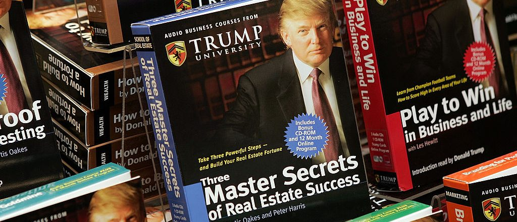 """Copies of """"How To Build Wealth,"""" which is a series of nine audio business courses created by Trump University, lie on display at a Barnes & Noble store January 10, 2005 in New York City"""