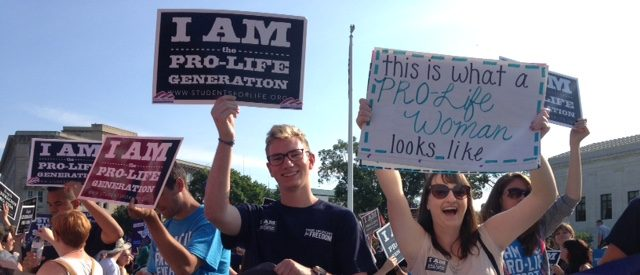 "Pro-lifers hold signs outside of the Supreme Court awaiting on the ruling ""Whole Woman's Health v. Hellerstedt. (Jake Henry / The Daily Caller)"