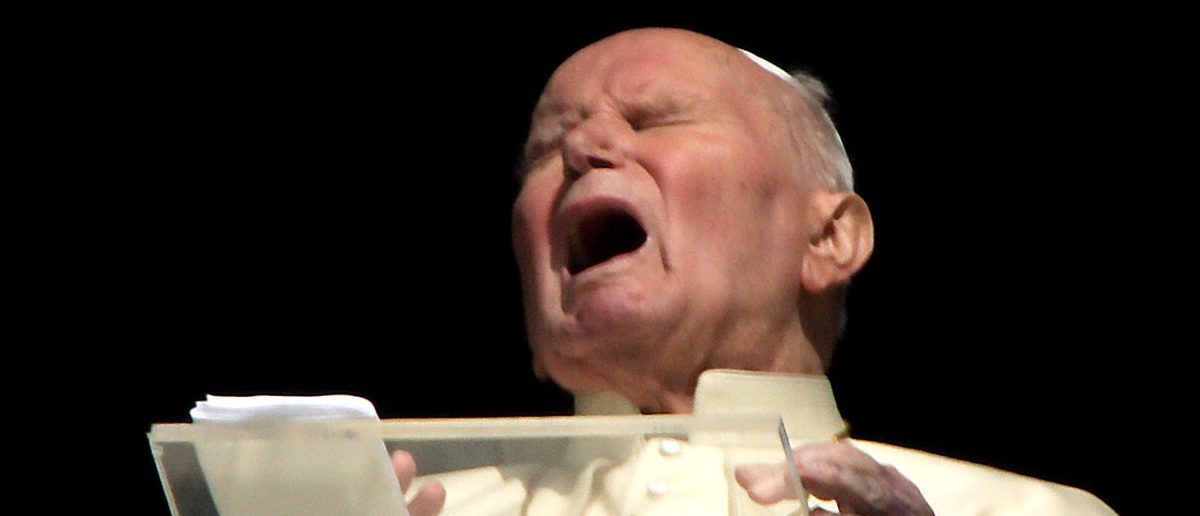 File photograph shows Pope John Paul II grimacing as he appears at the window of his private apartments at the Vatican. Pope John Paul II grimaces as he appears at the window of his private apartments at the Vatican in this file photograph taken on March 30, 2005. Pope John Paul, whose health deteriorated suddenly on Thursday, has received the Roman Catholic sacrament reserved for the sick and dying, Italian media reported. A Vatican spokesman said he could not confirm the reports but Church sources said it was likely the Pontiff had received the sacrament, given the precarious state of his health. File photograph taken on taken on March 30, 2005 REUTERS/Max Rossi