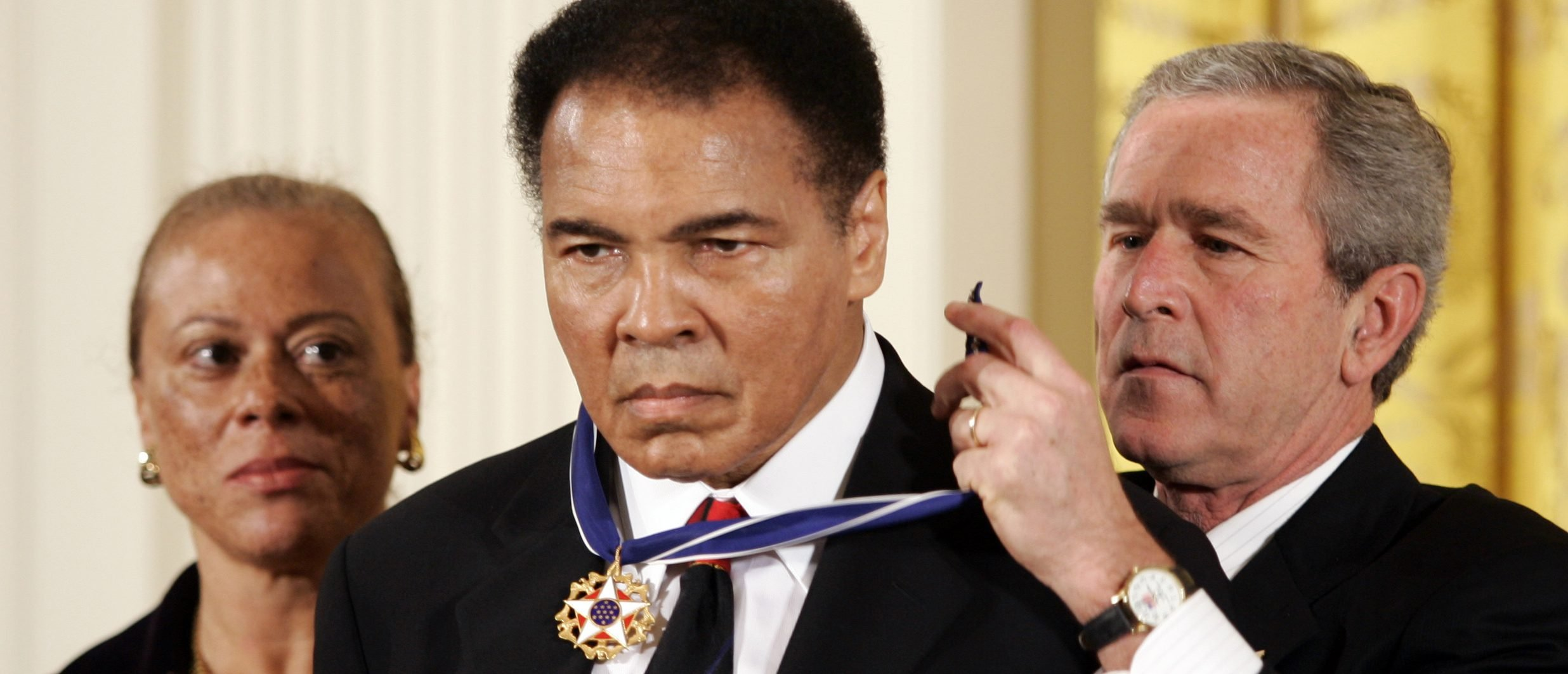 US President Bush awards boxing legend Muhammad Ali with the Presidential Medal of Freedom in Washington (Getty Images)