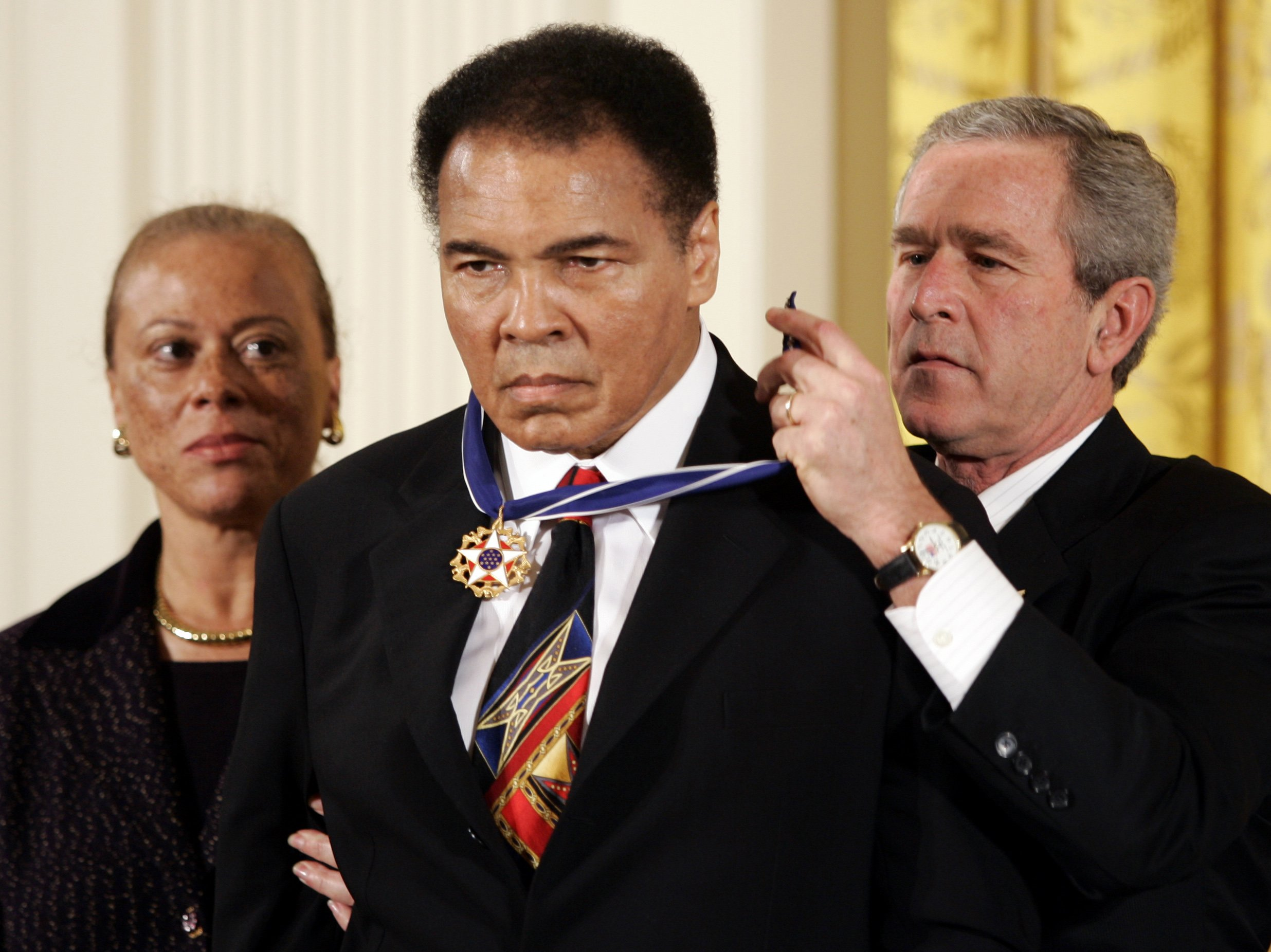 President George W. Bush awards boxing legend Muhammad Ali with the Presidential Medal of Freedom in Washington (Reuters Pictures)