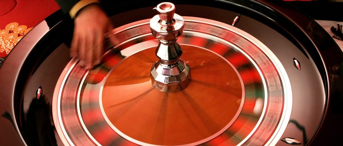 A croupier turns the roulette at the Brussels Casino owned by the Casinos Austria International November 25, 2005. The casino is the first to be built in Brussels. It has an area of 6200 square metres and offers 13 gaming tables, 201 slot machines, and will open on January 19, 2006. REUTERS/Francois Lenoir