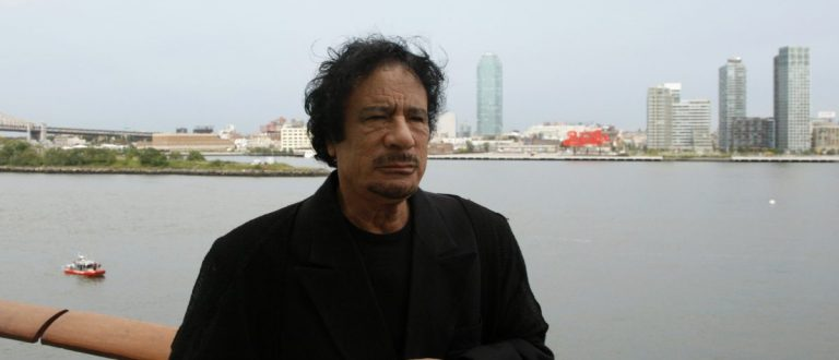 Libyan leader Muammar Gaddafi stands near a railing during a visit to the United Nations headquarters in New York September 22, 2009. Gaddafi was having a tent pitched on suburban New York property owned by Donald Trump on Tuesday until local officials stopped the work because it violated regulations, a town attorney said. Gaddafi, a famously eccentric figure known for pitching a large Bedouin tent on his trips abroad, was scheduled to address the U.N. General Assembly in New York on Wednesday. REUTERS/U.N. Photo/Evan Schneider/Handout