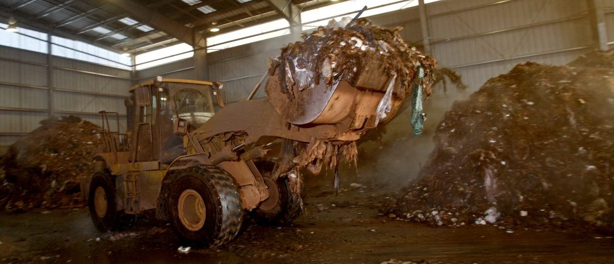 A front end loader moves a pile of shredded material at the Wilmington Organic Recycling Center in Wilmington, Delaware, January 8, 2010. Composting, long valued by gardeners, is just beginning to be adopted on the industrial scale exemplified by the Wilmington Organic Recycling Center, which claims to be the biggest of its kind on the East Coast of the United States. Picture taken January 8, 2010. To match Reuters Life! story ENVIRONMENT-COMPOSTING/ REUTERS/Tim Shaffer