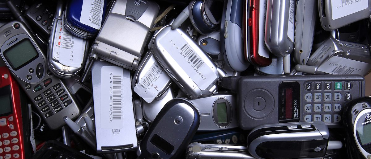 Hundreds of used cellphones sit waiting to be recycled at the offices of ECO ATM, a start-up company, in San Diego, California April 20, 2010. The eco-friendly company is building ATM type kiosks that allow a person to be instantly paid for recycling their old cell phone. Picture taken April 20, 2010. REUTERS/Mike Blake