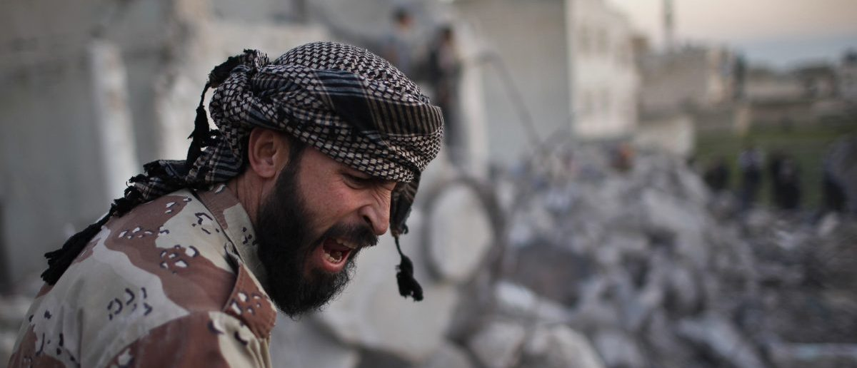 "A Free Syrian Army fighter reacts after an air strike by a fighter jet loyal to Syrian President Bashar al-Assad in Azaz city, North Aleppo, December 29, 2012. Syria faces ""hell"" if no deal is struck to end 21 months of bloodshed, an international mediator said on Saturday, but his talks in Russia brought no sign of a breakthrough after a week of intense diplomacy. REUTERS/Ahmed Jadallah"
