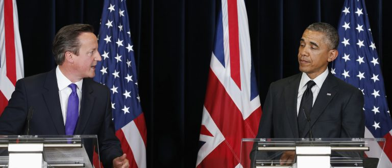 U.S. President Barack Obama reacts to a witty comment from British Prime Minister David Cameron during a news conference at the G7 Summit in Brussels June 5, 2014. The summit of the major economic powers had originally been planned for Sochi in?Russia?until Moscow was suspended from the group - then the G8 - over the Ukraine crisis.  REUTERS/Kevin Lamarque  (BELGIUM - Tags: POLITICS BUSINESS TPX IMAGES OF THE DAY) - RTR3SD9Z