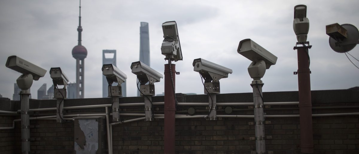 Security cameras are seen on a government building REUTERS/Aly Song - RTR4SAGJ
