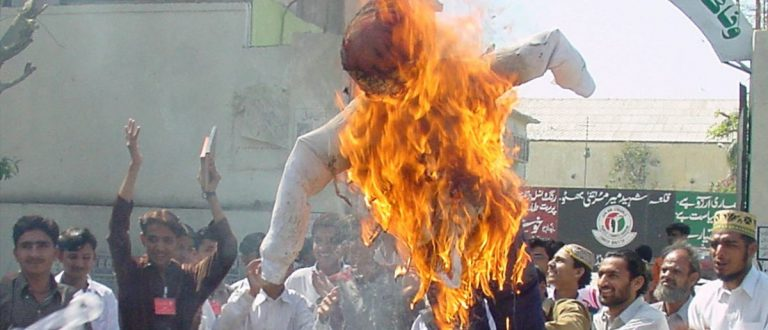 Pakistan students burn an effigy of U.S. President George W. Bush during an anti-U.S. rally in Karachi February 25, 2003. Students of Federal Urdu University held the rally on Tuesday to protest against a possible U.S.-led strike on Iraq. REUTERS/Akbar Baloch