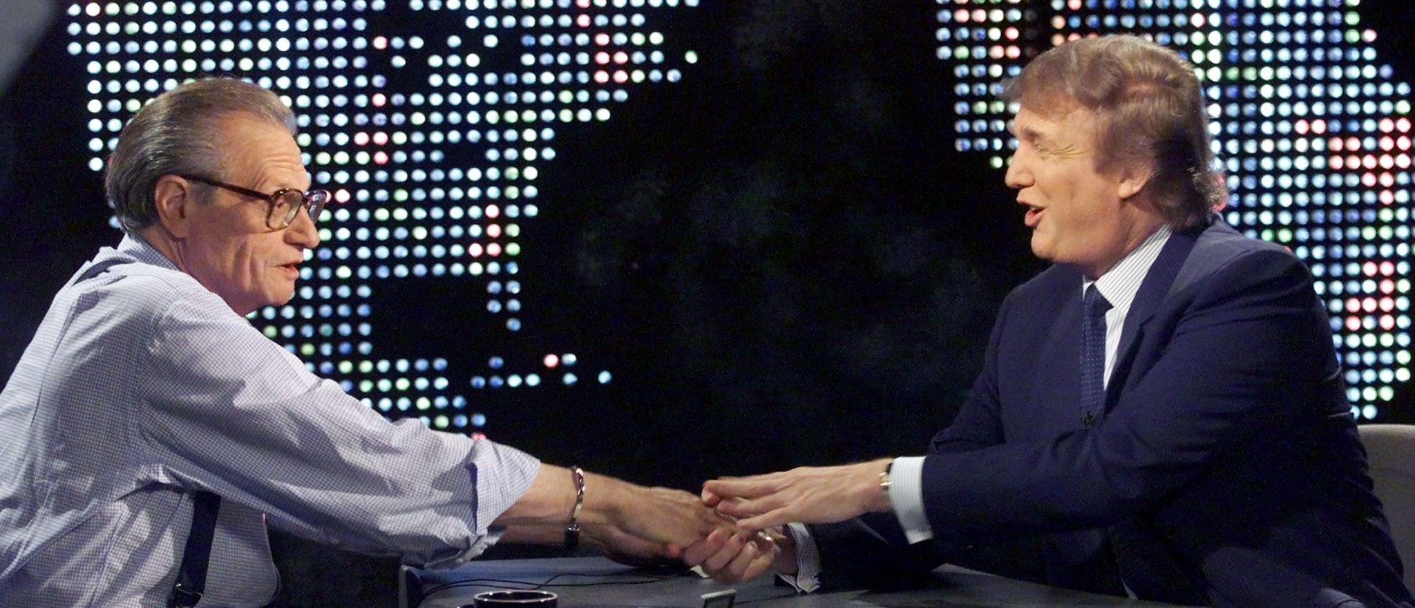 Billionaire real estate developer Donald Trump (R) shakes hands with host Larry King after taping a segment of King's CNN talk show, in New York October 7. Trump told King that he was moving toward a possible bid for the United States presidency with the formation of a presidential exploratory committee. Trump said he plans to confer later October 7 with Minnesota Governor Jesse Ventura, who has been courting him for months to seek the presidential nomination of the Reform Party.  PM/HB - RTRRCIO