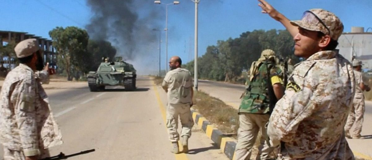 Soldiers from a force aligned with Libya's new unity government walk along a road during an advance on the eastern and southern outskirts of the Islamic State stronghold of Sirte, in this still image taken from video on June 9, 2016. via Reuters TV