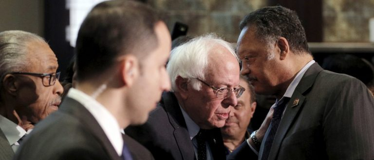 U.S. Democratic presidential candidate and U.S. Senator Bernie Sanders and the Reverend Jesse Jackson talk at the National Action Network national convention in New York April 14, 2016. REUTERS/Brian Snyder