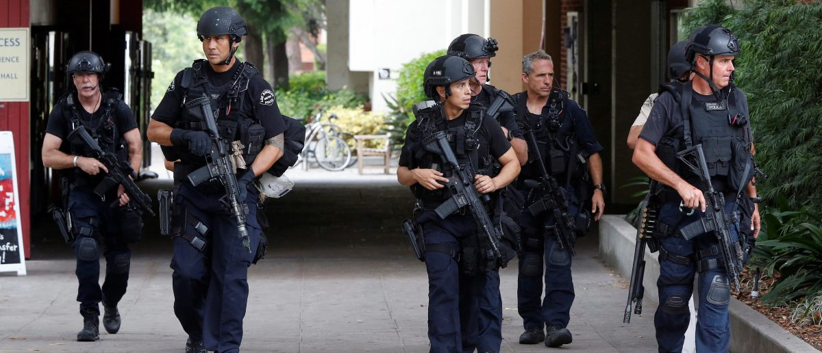 Police officers conduct a search at the University of California, Los Angeles (UCLA) campus after it was placed on lockdown following reports of a shooter that left 2 people dead in Los Angeles, California June 1, 2016. REUTERS/Patrick T. Fallon