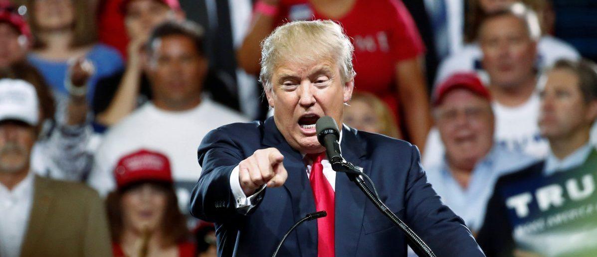 Republican U.S. Presidential candidate Donald Trump speaks at a campaign rally in Phoenix, Arizona, June 18, 2016. REUTERS/Nancy Wiechec - RTX2GZ6I