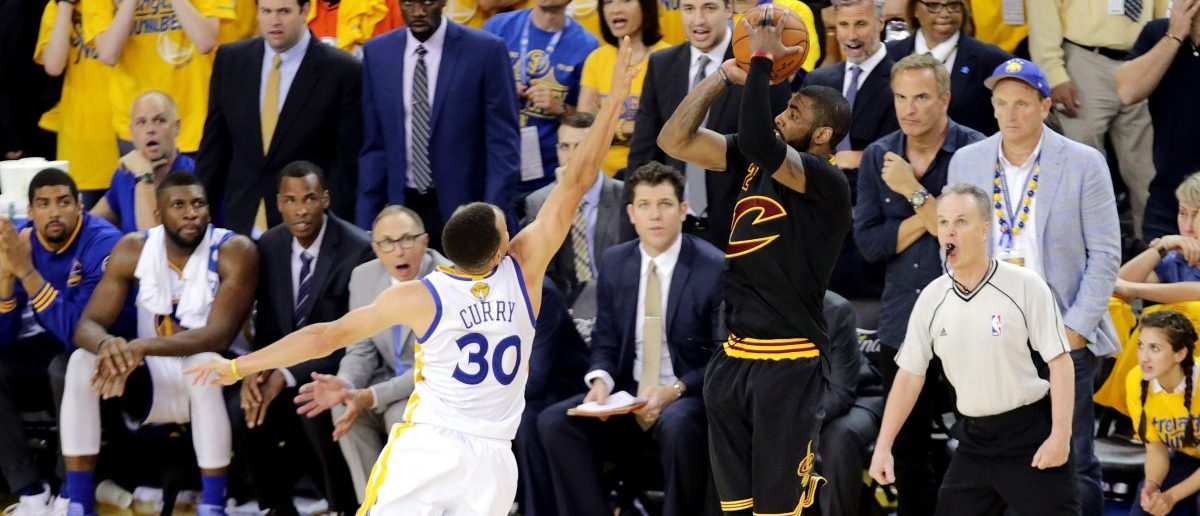 Kyrie Irving hits a late three-pointer over Steph Curry (Photo: Reuters)