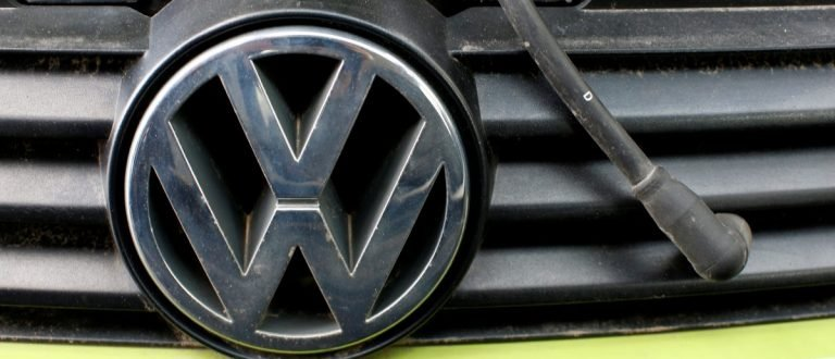 File picture of a Volkswagen logo on a car's front at a scrapyard in Fuerstenfeldbruck