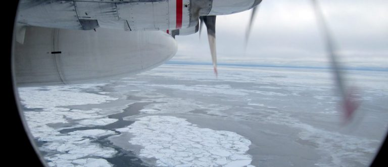 """Broken Arctic sea ice as seen from a window in from a U.S. Coast Guard C130 flight over the Arctic Ocean September 30, 2009. The flights are part of a regular """"Arctic Domain Awareness"""" program in which regular overflights are staged to get a sense of the environment and conditions far offshore. The oldest ice is tinged with blue, and the newest ice is seen as a thin film on the water between existing ice chunks. Photo taken September 30, 2009.   REUTERS/Yereth Rosen   (UNITED STATES ENVIRONMENT SCI TECH) - RTXP8EP"""