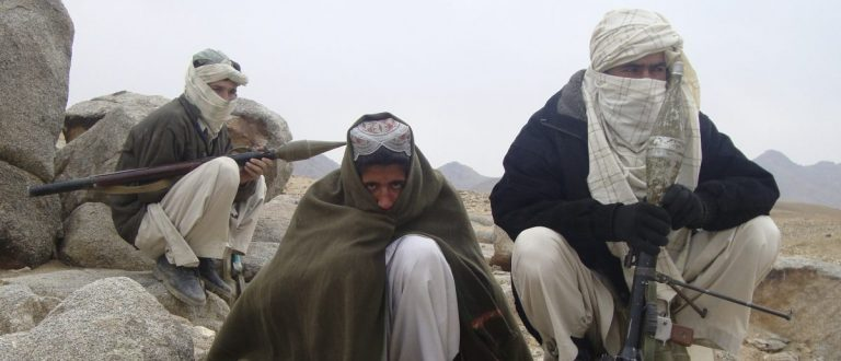 Taliban fighters pose with weapons in an undisclosed location in Afghanistan October 30, 2009. The Taliban have called on Afghans to boycott the election run-off and have vowed to disrupt the poll, their threat underlined on October 28 by a suicide attack on a Kabul guest-house used by the United Nations in which five foreign U.N. staff were killed. Picture taken October 30, 2009. REUTERS/Stringer