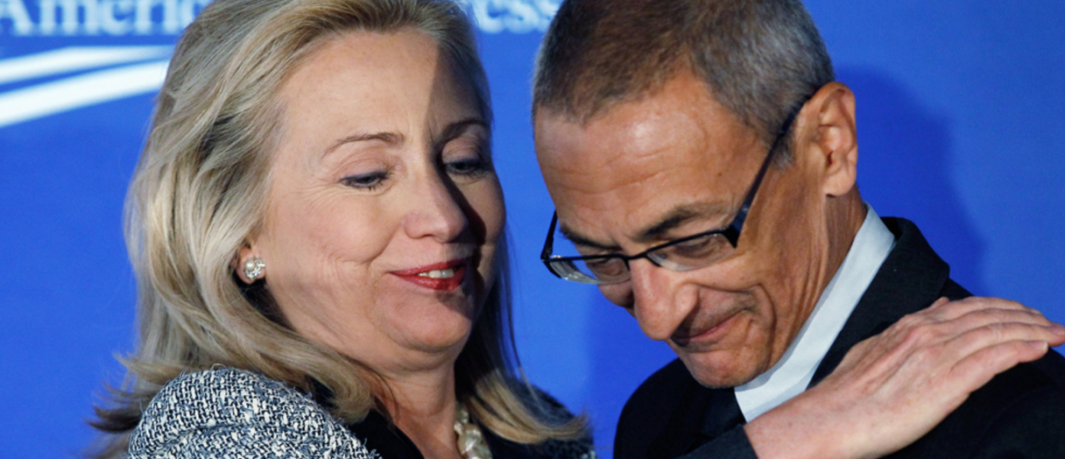 John Podesta and Hillary Clinton; October 12, 2011. PHOTOGRAPH BY CHIP SOMODEVILLA / GETTY