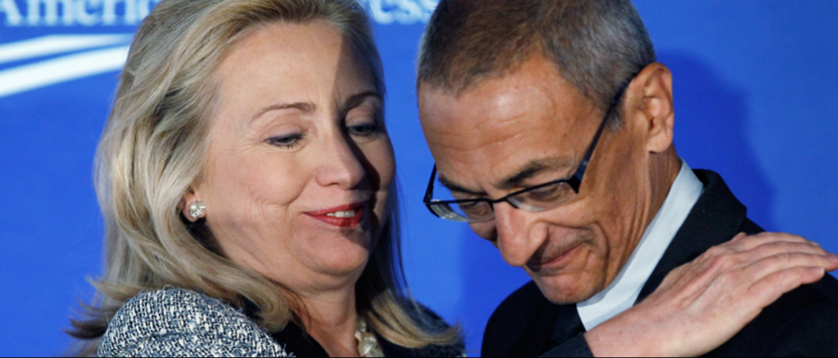 John Podesta and Hillary Clinton: October 12, 2011. PHOTOGRAPH BY CHIP SOMODEVILLA / GETTY IMAGES