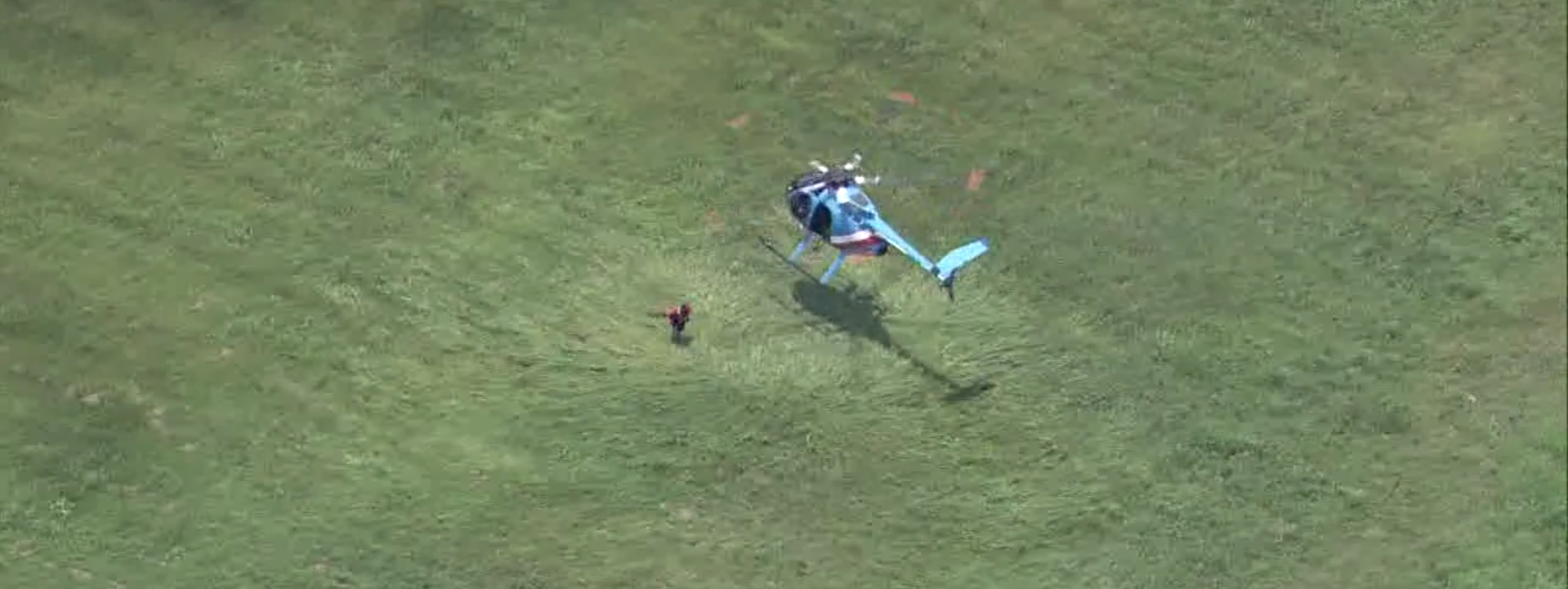 Screenshot from Fox local video of police helicopter pilot tackling suspect.