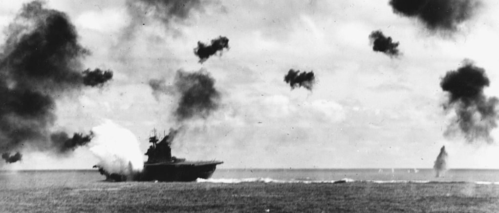 USS Yorktown (CV-5) is hit on the port side