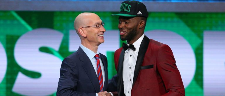 Jaylen Brown greets NBA commissioner Adam Silver after being selected as the number three overall pick to the Boston Celtics in the first round of the 2016 NBA Draft at Barclays Center