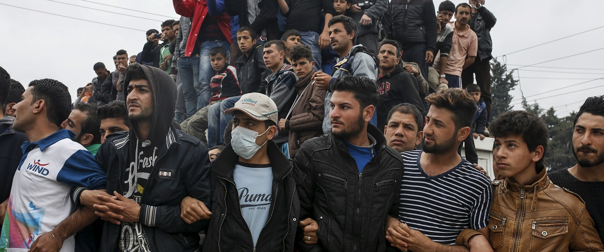 Migrants and refugees gather to listen to Nadia Murad Basee Taha (not pictured), an Iraqi woman of the Yazidi faith who was abducted and held by the Islamic State for three months, at the Greek-Macedonian border near the village of Idomeni, Greece, April 3, 2016. REUTERS/Marko Djurica.
