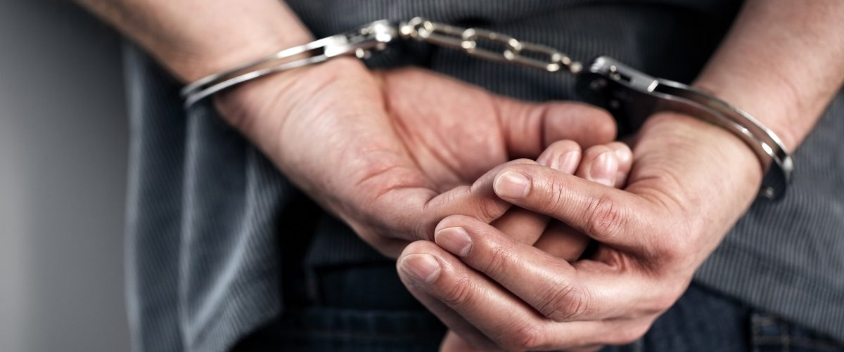 Man In Handcuffs (Shutterstock)