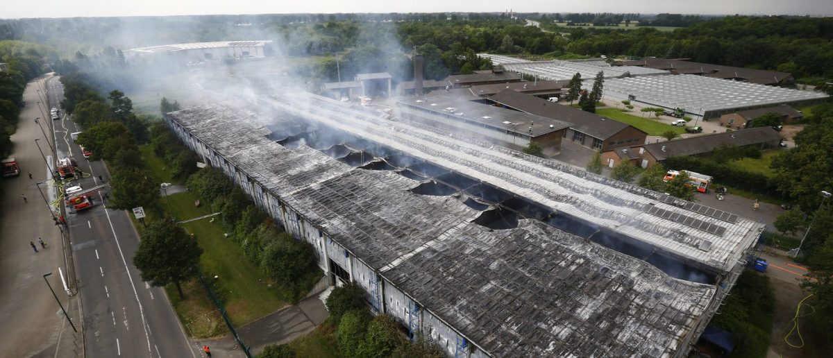 An aerial picture shows exhibition halls used as refugee camps after they were damaged in a fire in Duesseldorf, Germany, June 7, 2016. REUTERS/Wolfgang Rattay