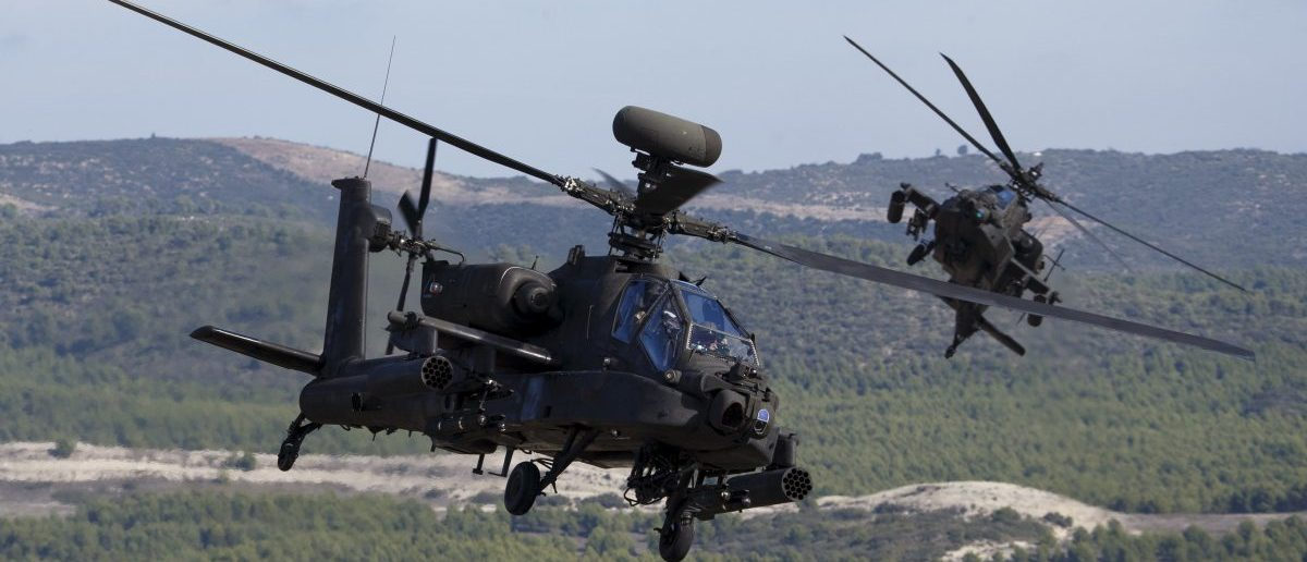 NATO forces in AH-64 Apache helicopters take part in Exercise Trident Juncture 2015, NATO's largest  joint and combined military exercise in more than a decade, at the San Gregorio training grounds outside Zaragoza, Spain, November 4, 2015. Some 36.000 personnel from more than 35 nations, including all NATO Allies  will have participated in Exercise Trident Juncture 2015 which began on 21 October, in Italy, Portugal and Spain, including their adjacent waters and airspace and runs till November 6.  REUTERS/Paul Hanna
