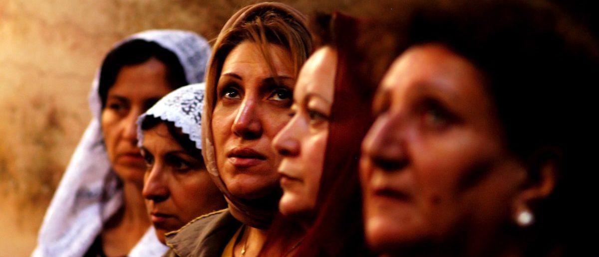Christian women pray at a mass in Jerusalem. Source: ChameleonsEye/Shutterstock