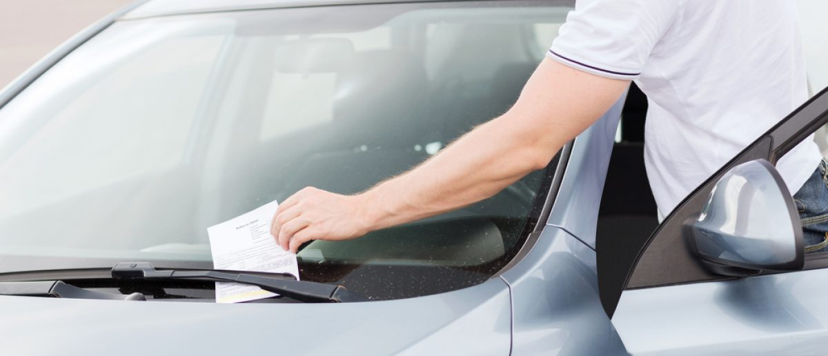 Parking ticket on car windshield. [Shutterstock- Syda Productions]