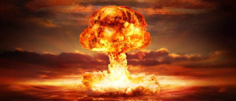 A nuclear bomb goes off over the ocean. Source: Romolo Tavani/Shutterstock