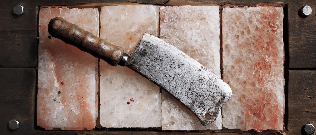 Vintage Meat cleaver on Himalayan pink salt /SHUTTERSTOCK