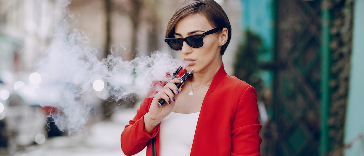 Young woman smoking an e-cigarette (Credit: Shutterstock/Oleg Baliuk)