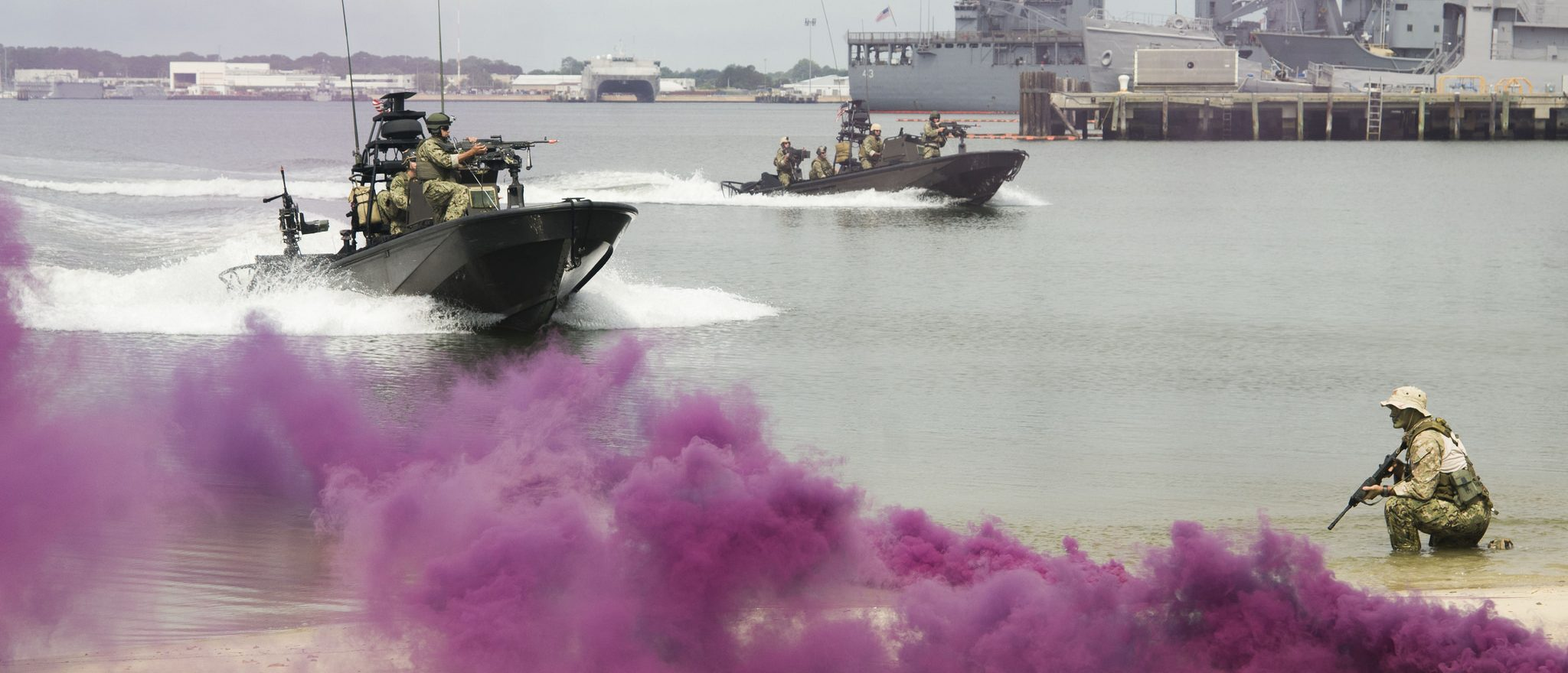 Members of SEAL Team 18 perform a demonstration at Joint Expeditionary Base Little Creek for the 2014 Navy Employer Recognition Event. (US Navy official)