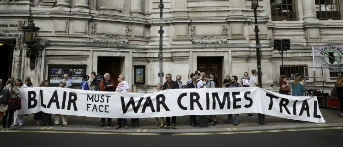 Demonstrators protest before the release of the John Chilcot report into the Iraq war, at the Queen Elizabeth II centre in London, Britain July 6, 2016.    REUTERS/Paul Hackett